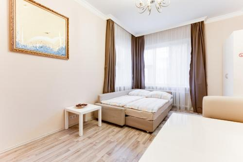 A bed or beds in a room at Apartment Masná 21