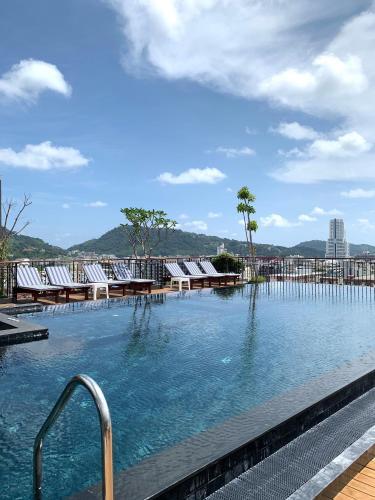 The swimming pool at or near Rak Elegant Hotel Patong