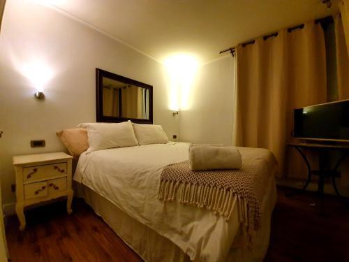 Cama o camas de una habitación en RAE Apumanque Center