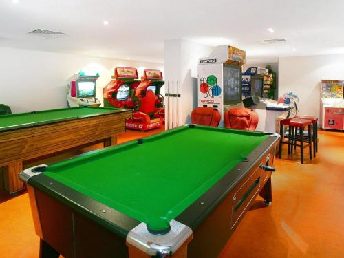 A pool table at Chevron Renaissance 2 Bed Ocean + River View