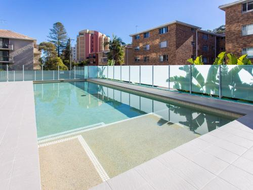 The swimming pool at or near Shores 303