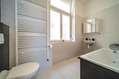 A bathroom at Avantguard Apartments
