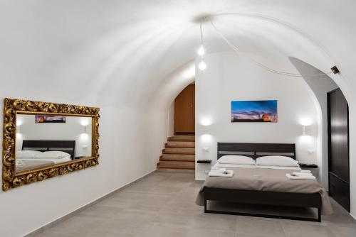 A bed or beds in a room at Casa Vacanze Al Duomo Ibla