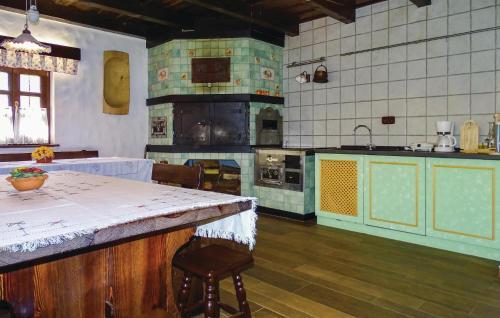 Kuhinja oz. manjša kuhinja v nastanitvi Two-Bedroom Holiday Home in Murska Sobota