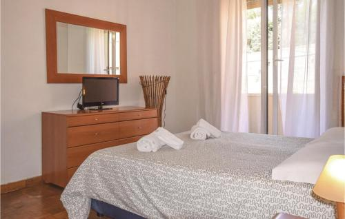 A bed or beds in a room at Terrace Home on Vatican