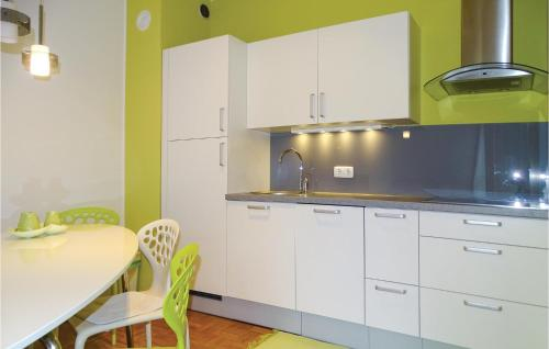 A kitchen or kitchenette at One-Bedroom Apartment in Bohinjska Bistrica