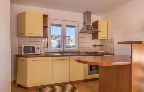 A kitchen or kitchenette at One-Bedroom Holiday Home in Ankaran
