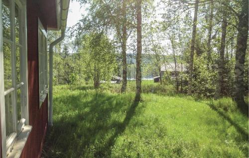 En trädgård utanför Holiday Home Bergsjo with Lake View I
