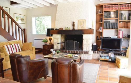 A seating area at Four-Bedroom Holiday Home in Bagnoles de l'Orne