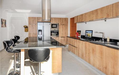 A kitchen or kitchenette at Holiday Home Chemin 18