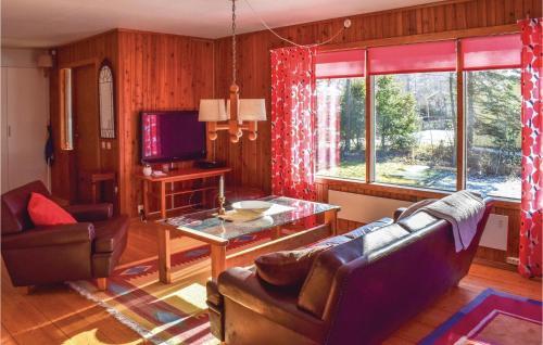 En sittgrupp på Three-Bedroom Holiday Home in Strandbaden