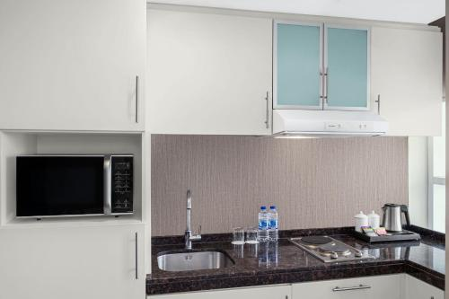 A kitchen or kitchenette at Leva Hotel and Suites, Mazaya Centre