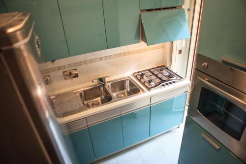 Kuchyň nebo kuchyňský kout v ubytování Colosseo Home 161