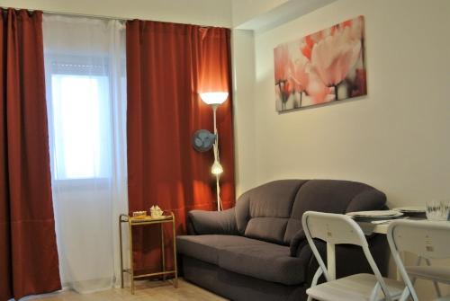 Zona de estar de L'appartement IRINA