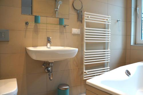 A bathroom at small luxus apartment