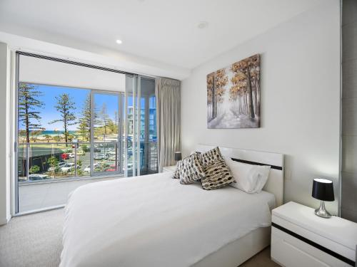 A bed or beds in a room at Nirvana By The Sea