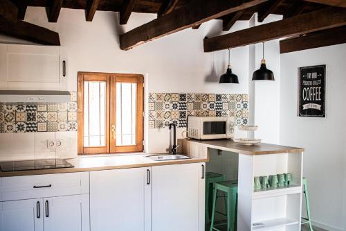 Una cocina o zona de cocina en Atico con vistas