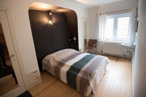 Un ou plusieurs lits dans un hébergement de l'établissement Clos Normand