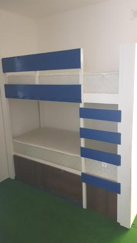 A bunk bed or bunk beds in a room at House bedroom