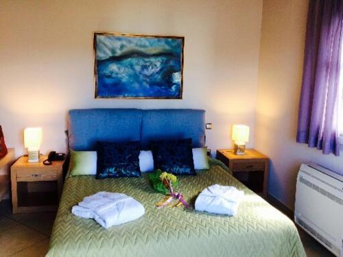 Кровать или кровати в номере Castri Village