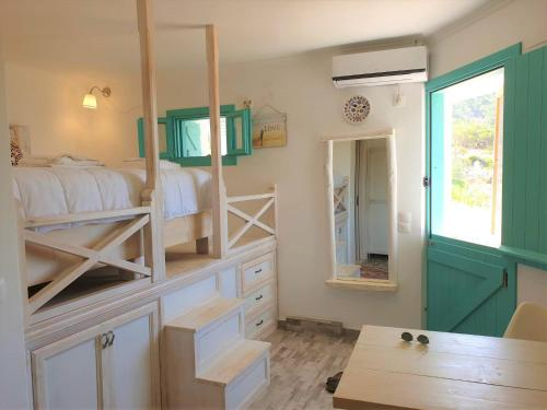 A bunk bed or bunk beds in a room at Kathys Island Retreat