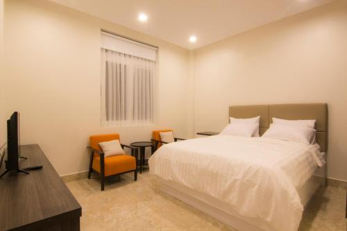 A bed or beds in a room at Cassabella Hotel & Apartments