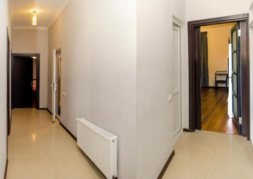 A television and/or entertainment center at Apartment Amaghleba