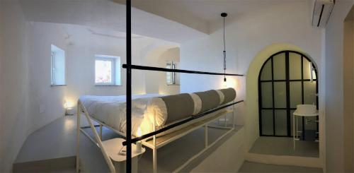 Letto o letti a castello in una camera di Eremo di Montevergine Ischia Apartments