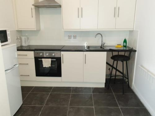A kitchen or kitchenette at A Studio Apartment with private facilities