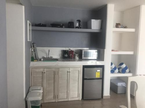 A kitchen or kitchenette at Estudios Yalmakan