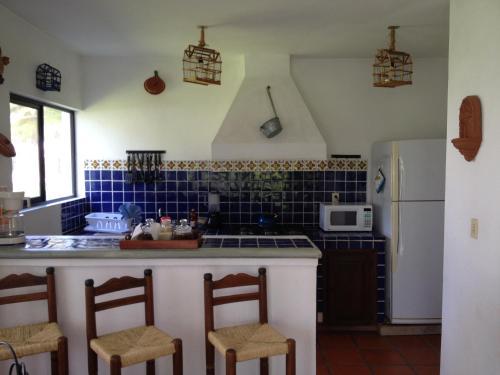 A kitchen or kitchenette at Villas Balvanera FH
