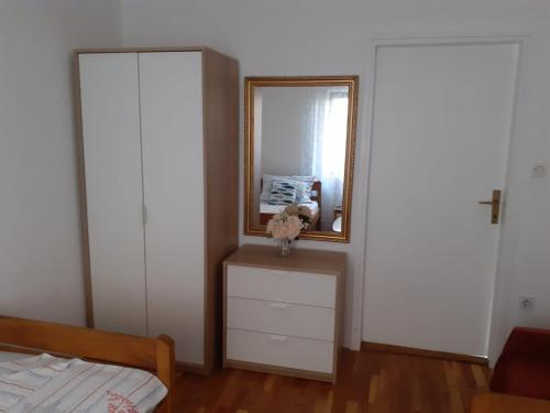 A television and/or entertainment center at Apartments Dominik
