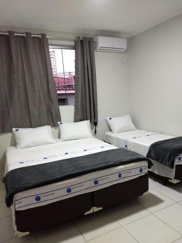 Cama o camas de una habitación en Hotel Flor Paulista