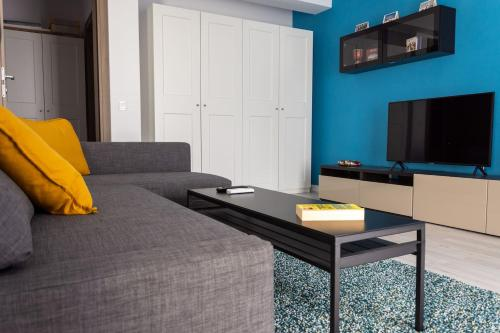 A television and/or entertainment center at Comfy modern studio in 21 Residence - Politehnica