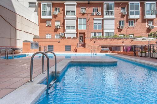 The swimming pool at or near SUPER DUPLEX IFEMA - AEROPUERTO