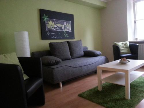 Ein Sitzbereich in der Unterkunft Ferienwohnungen Ostengasse 22