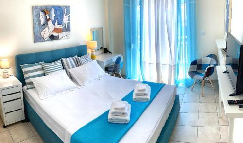 Postel nebo postele na pokoji v ubytování Downtown Thassos