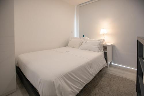 Cama ou camas em um quarto em Aveiro´s Dock Apartments
