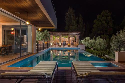 The swimming pool at or near Olive Hills Villa