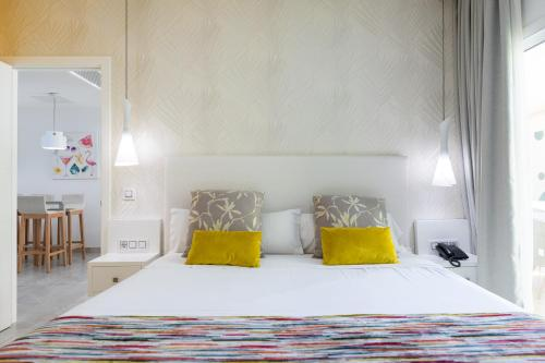 Säng eller sängar i ett rum på Holiday Club Playa Amadores