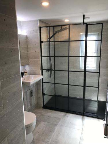 Een badkamer bij Westhall Annex