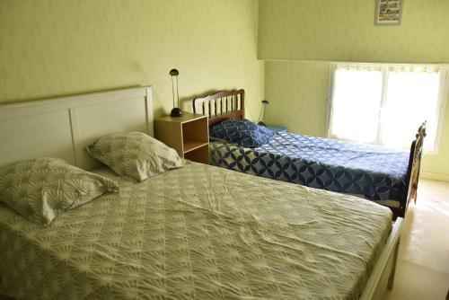 Un ou plusieurs lits dans un hébergement de l'établissement Maison indépendante dans le vignoble de Bordeaux