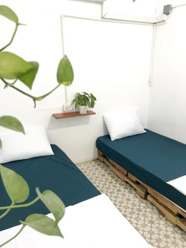 A bed or beds in a room at Sacred Lotus Cafe