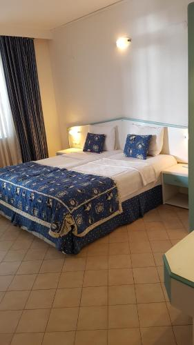 Lova arba lovos apgyvendinimo įstaigoje Belle Ocean Apart Otel