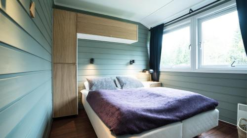 A bed or beds in a room at Ski, fish, golf, hiking in Hemsedal