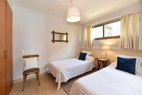 A bed or beds in a room at Villa Carlota