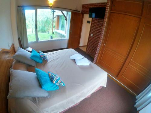 A bed or beds in a room at Haras del Bosque