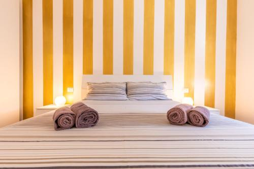 A bed or beds in a room at Casa Vacanze Terracina