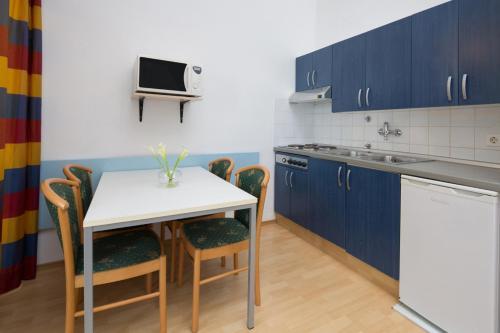A cozinha ou cozinha compacta de Lanterna Sunny Resort by Valamar