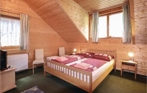 A bed or beds in a room at Stunning home in Gargellen w/ 8 Bedrooms